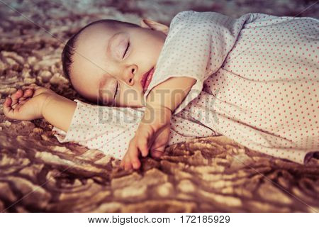 Cute newborn baby sleeping on the bed