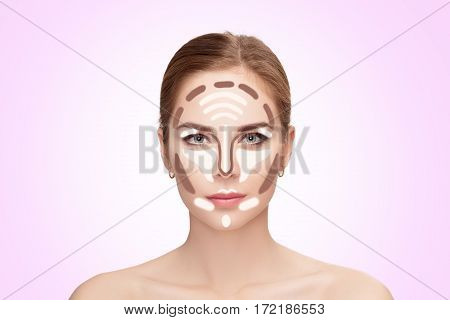 Contouring. Make up woman face on pink background. Contour and highlight makeup. Professional face make-up sample