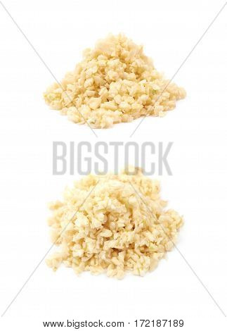 Pile of minced garlic isolated over the white background, set of two different foreshortenings
