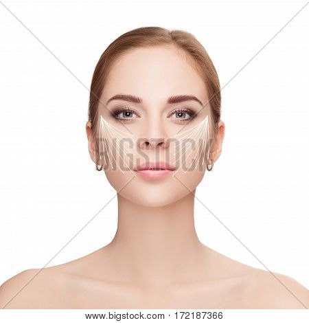 Spa portrait of attractive woman with arrows on her face over white background. Face lifting concept. Plastic surgery treatment, medicine