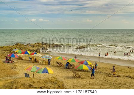 GUAYAS, ECUADOR, FEBRUARY - 2016 - People at the beach in engabao a small fisher's town located at the coast of pacific ocean in Ecuador