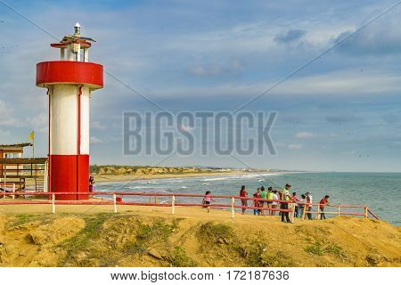 GUAYAS, ECUADOR, FEBRUARY - 2016 - People at lighthouse in engabao a small fisher's town located at the coast of pacific ocean in Ecuador