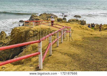 GUAYAS, ECUADOR, FEBRUARY - 2016 - People at rocky coast in engabao a small fisher's town located at the coast of pacific ocean in Ecuador