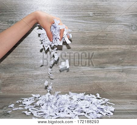 Abstraction of broken relationships. A lot of torned pieces of paper