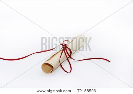 Paper bundle with red ribbon. Isolated on white background.