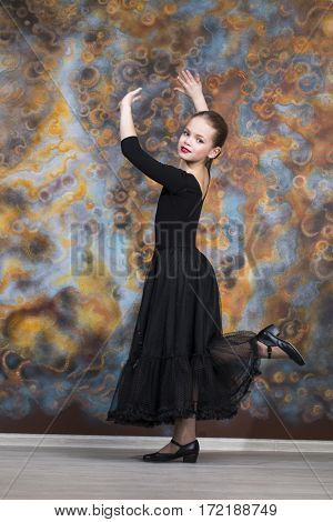 Black Swan. The young beautiful dancer in black dress dancing in the studio