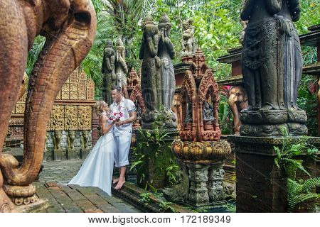 Bride and Groom Walking in Asian Style Park