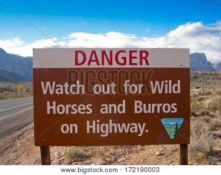Sign warning of wild horses and burros on highway. Nevada USA