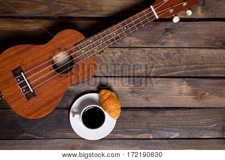 Ukulele Ukulele With Cup Of Coffee And Croissant