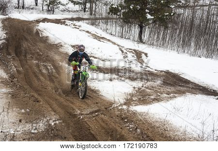 KYIV UKRAINE - FEBRUARY 15 2015: Motorcyclist training on a winter race track.