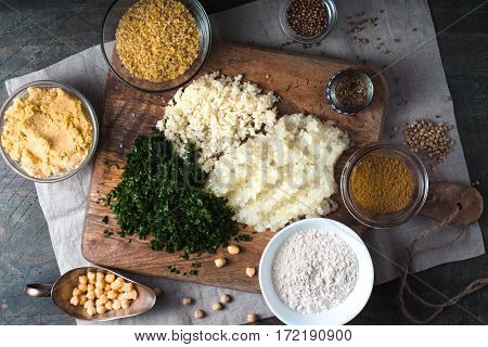 Ingredients for Falafel bulgur cilantro onion garlic and spices horizontal