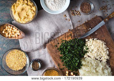 Chickpeas onion garlic parsley bulgur spices for falafel horizontal