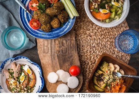 Festive table with falafel vegetable Salad and drinks horizontal