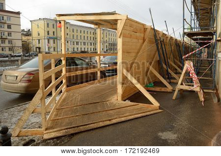 The wooden tunnel on the street built at the construction site.