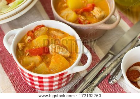 Hungarian chicken paprikash stew with bell pepper and potatoes
