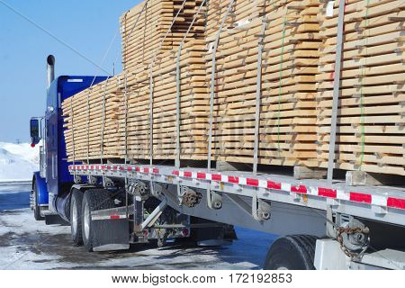 truck carrying wood forestry transport plank stack