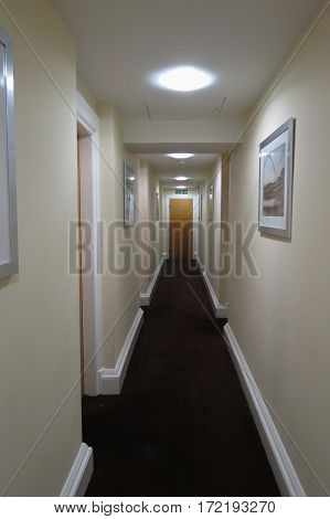 NEWCASTLE UPON TYNE UK - CIRCA AUGUST 2015: perspective of interior of hotel corridor with doors leading to rooms