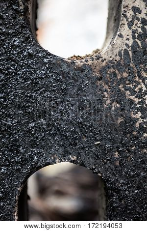 Concrete block stained with black tar. Close up.