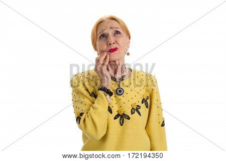 Old woman having toothache. Upset lady looking up isolated. Pain caused by gum disease.