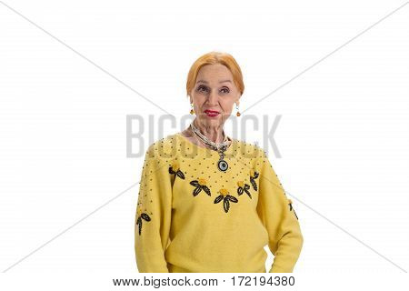 Old lady on white background. Displeased senior lady. Trust no one.