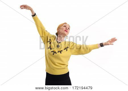 Dancing senior woman isolated. Lady with raised arms. Former ballet dancer.