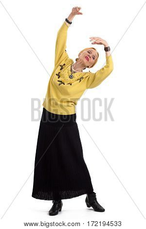 Old woman dancing. Senior lady isolated. Live by art.