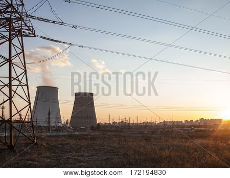 Cooling towers of the cogeneration plant near Kyiv Ukraine. Electricity pylon in the foreground.