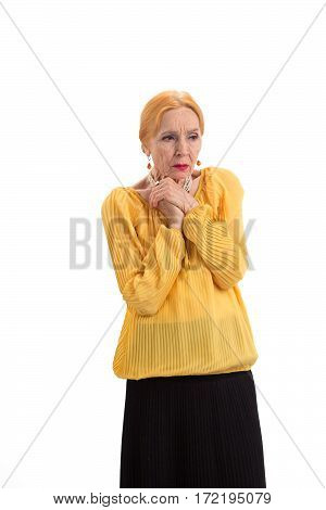 Worried old woman. Sad lady on white background. Live by hope.
