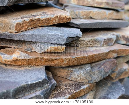 Stack of the flat stones for the masonry in the construction site. Close-up.