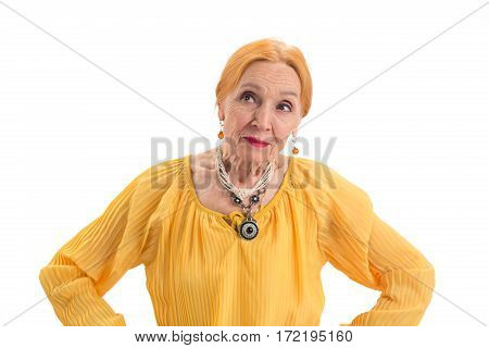 Thoughtful old woman. Senior female isolated. Evaluate pros and cons.