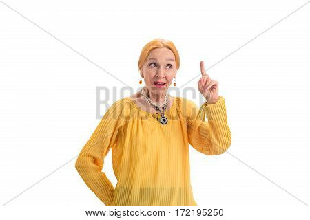 Senior woman with raised finger. Thoughtful lady on white background. Philosophy and moral.