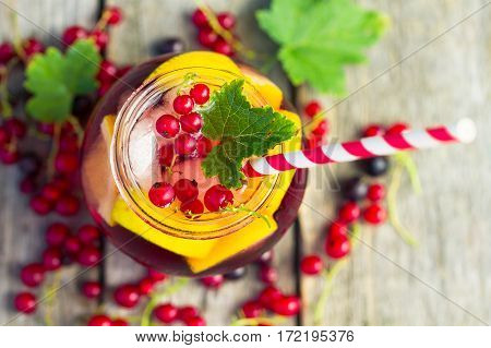 Red Currant Drink On Wooden Table