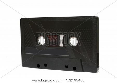 Old compact audio cassette tape at the white background