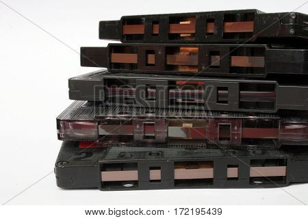 Old compact audio cassette tapes at the white background