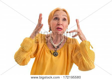 Annoyed woman on white background. Stressed senior lady. Waste of nerves.