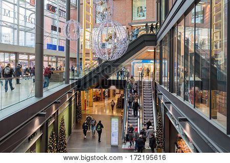 DUISBURG GERMANY - DECEMBER 17 2016: Unknown people in shopping mall 'Forum' in Duisburg Germany