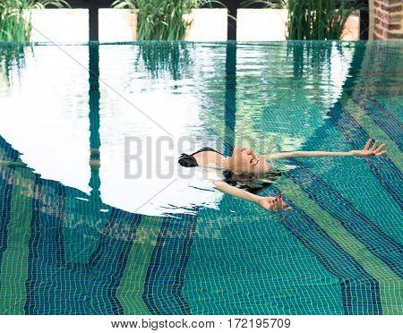 Beautiful Young Woman Relaxing In A Spa Resort