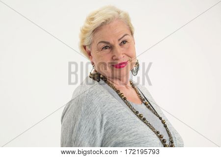 Senior woman isolated. Lady on white background. Self confidence tips.