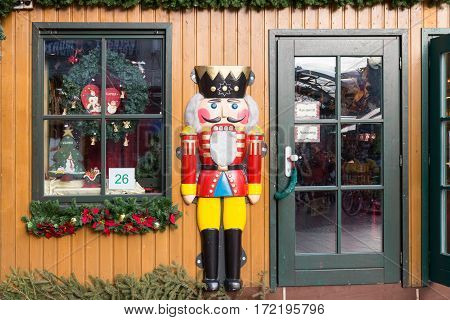 DUISBURG GERMANY - DECEMBER 17 2016: Wooden shop with decorations at Christmas fair in Duisburg Germany