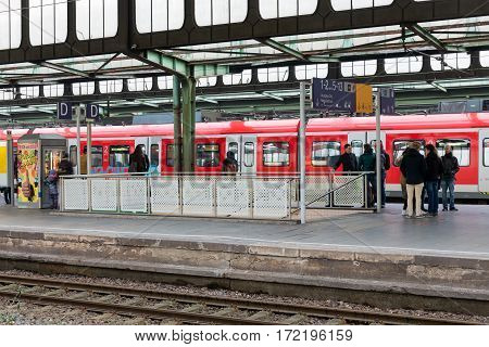 DUISBURG GERMANY - DECEMBER 17 2016: Travellers and trains at the main station of Duisburg in Germany