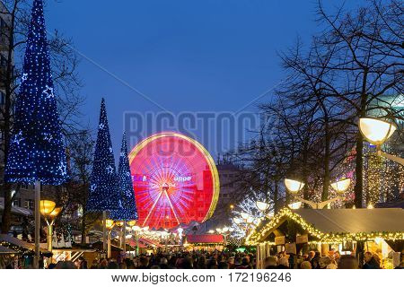 DUISBURG GERMANY - DECEMBER 17 2016: Traditional christmas market with illuminated ferris wheel in the center of Duisburg Germany