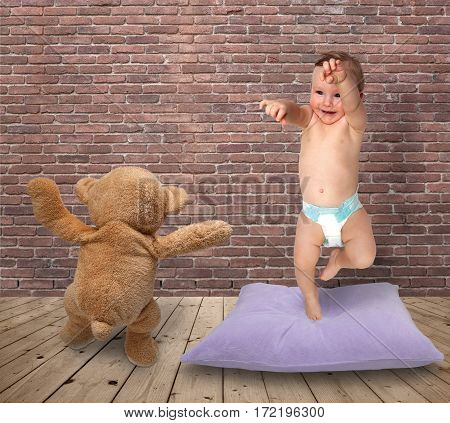 little boy dancing with her teddy bear