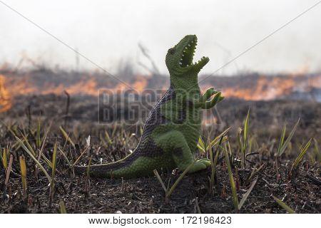 Dinosaur model on the burning field background.