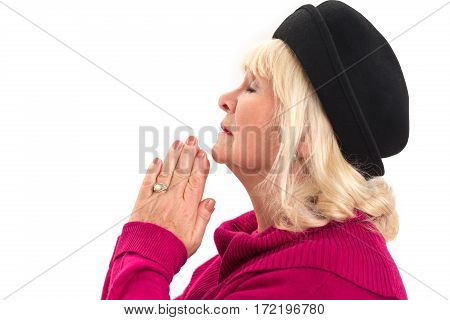 Side view of woman praying. Lady with closed eyes isolated.