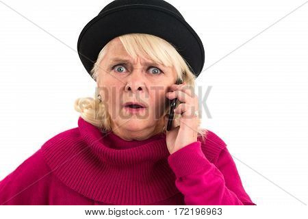 Scared senior woman with cellphone. Frightened woman on white background. Hear the threatening voice. poster