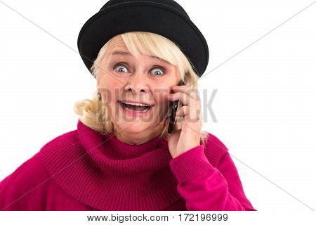 Surprised lady holding cell phone. Senior woman on white background. Mobile operator with best tariffs.