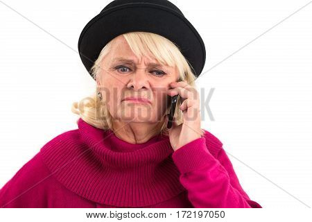 Upset woman with cell phone. Face of lady showing disgust. The unpleasant talk.
