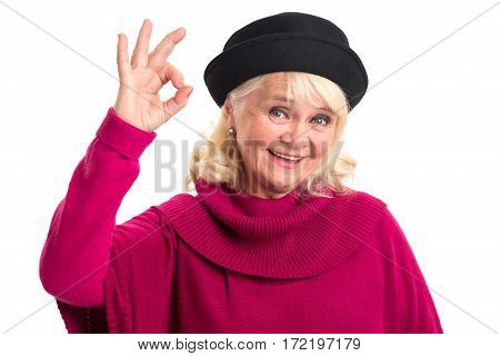 Old woman showing ok gesture. Happy female on white background. Success starts from mindset.