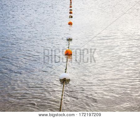 Safety rope and float line on the water.
