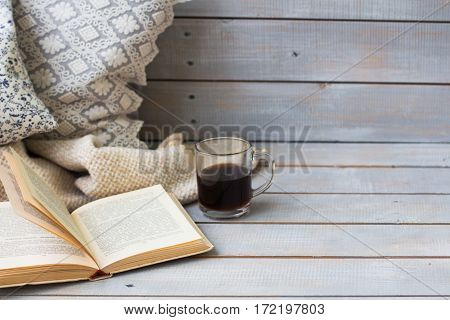 Cushions, Plaid, Black Coffee And Old Book On The White Wooden Background, Closeup.